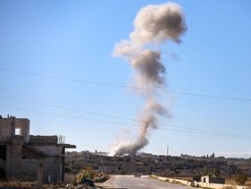 Smoke rising from the town of Kafr Ruma in the south of Syria's northwestern Idlib province following a reported air strike there, December 3, 2019