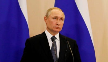 Russian President Vladimir Putin looks on during a joint press conference with his Serbian counterpart following their talks in Sochi, Russia on December 4, 2019.