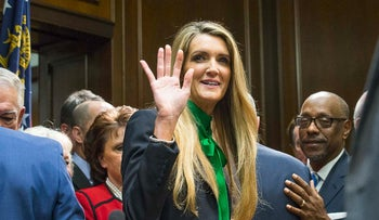 Newly appointed U.S. Sen. Kelly Loeffler waves toward supporters following a press conference in the governor's office at the Georgia State Capitol Building, Wednesday, Dec. 4, 2019