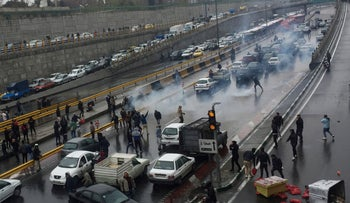 Iranians protest against increased gas price, on a highway in Tehran, November 16, 2019.