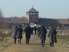 Members of Langage de Femmes on a tour of the Auschwitz death camp run by the Nazis in Poland. founders Suzanne Nakache, left, and Samia Essabaa.