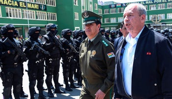 Bolivian interim Interior Minister Arturo Murillo walks next to the National Police chief Rodolfo Montero in La Paz, December 3, 2019.