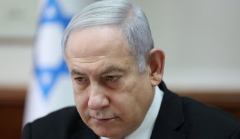 Netanyahu chairs the weekly cabinet meeting at his office in Jerusalem on December 1, 2019.