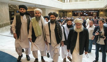 Members of the Taliban delegation arrive for talks in Moscow, Russia, May 28, 2019.