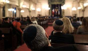 Members of the Jewish community attend services in Park East Synagogue in Manhattan, February 19, 2015.