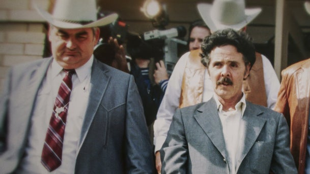 """Henry Lee Lucas, center, with Texas Ranger Bob Prince to his left, in a still from Netflix's """"The Confession Killer."""""""