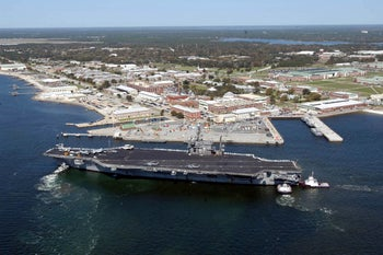 The aircraft carrier USS John F. Kennedy arrives for exercises at Naval Air Station Pensacola, Florida, U.S. March 17, 2004