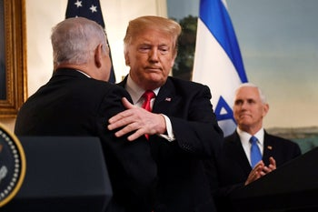 Trump and Netanyahu embrace in the Oval Office, March 25, 2019.