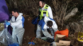 Police forensics team investigates the site where Khatib's body was found, December 5, 2019.
