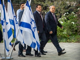 Joint List leaders Ahmad Tibi (R) and Ayman Odeh come to the Israeli President's residence for a meeting, September 22, 2019