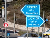 Signs on the road between Tel Aviv and Ramallah, January 5, 2018