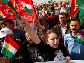 Iraqi Kurds protesting the Turkish offensive against Syria during a demonstration outside the United Nations building in Erbil, Iraq, October 12, 2019.