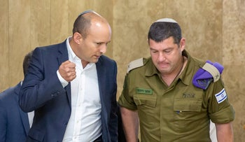 Defense Minister Naftali Bennett talks to his military secretary, Ofer Winter, at the Knesset in Jerusalem, November 13, 2019.
