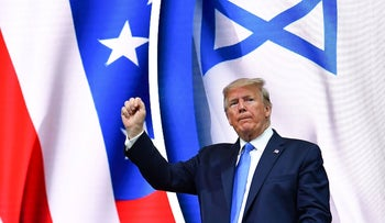 Donald Trump stands on stage after his address to the Israeli American Council National Summit in Florida on December 7, 2019.