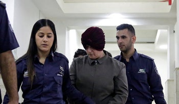 Australian Malka Leifer, center, is brought to a courtroom in Jerusalem, February 27, 2018