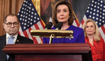 House Speaker Nancy Pelosi speaks next to House Judiciary Chairman Jerry Nadler, Democrat of New York, House Permanent Select Committee on Intelligence as they announce articles of impeachment for U.S. President Donald Trump during a press conference at the US Capitol in Washington, DC, December 10, 2019.