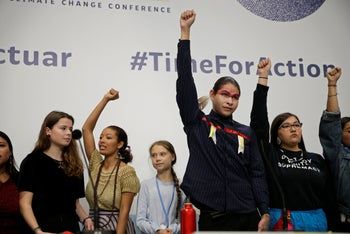 Thunberg, center, stands with other young activists at the COP25 Climate summit in Madrid, Spain, December 9, 2019.