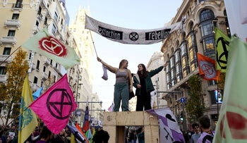 People attend an Extinction Rebellion protest on Gran Via street, Madrid, Spain, December 7, 2019.