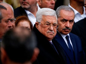Palestinian President Mahmoud Abbas, center, attending the funeral of former senior Fatah official Ahmed Abdel Rahman in Ramallah, December 4, 2019.