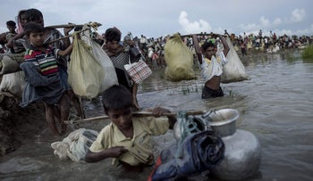 Some of the 740,000 Rohingya refugees forced to seek refuge in neighboring Bangladesh, fleeing a ferocious crackdown by the Myanmar military, October 10, 2017