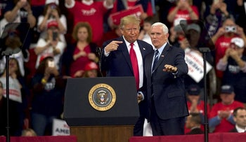 U.S. President Donald Trump gestures with US Vice President Mike Pence during a campaign rally on December 10, 2019 in Hershey, Pennsylvania