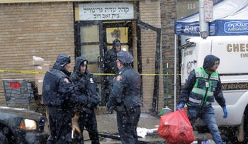 Emergency responders work near a kosher supermarket and a synagogue near the site of shooting in Jersey City, N.J., December 11, 2019.