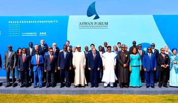 Dignitaries including Abdel-Fattah el-Sissi, center, gather, for a photo during a two-day forum on peace in Africa in the southern city of Aswan, Egypt, December 11, 2019.