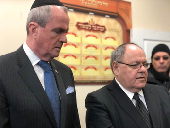 Governor Phil Murphy (L) and Israel's Consul General in New York Dani Dayan participating in a prayer service at the Chabad synagogue above the JC supermarket, December 11, 2019.