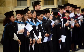 Graduates gathering outside the Sheldonian Theatre after a graduation ceremony at the University of Oxford, England, July 2017.