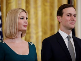 White House senior advisers Ivanka Trump and Jared Kushner standing behind U.S. President Donald Trump as he speaks during the Hanukkah reception in the White House, Washington, December 11, 2019.