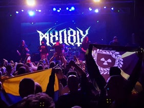 A photo, posted on a Discord neo-Nazi chat on February 2, 2018, showing a performance by M8L8TH at Asgardsrei in Kiev. An Atomwaffen Division flag can be seen in the audience.