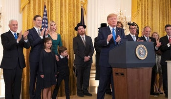 President Donald Trump with, first lady Melania Trump, Vice President Mike Pence, from left, Jared Kushner and Ivanka Trump and their children Arabella Kushner and Joseph Kushner, applaud during a Hanukkah reception in the East Room of the White House Wednesday, Dec. 11, 2019, in Washington