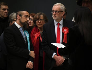 British opposition Labour Party leader Jeremy Corbyn, right,  waits for the declaration of his seat in the 2019 general election in Islington, London, December 13, 2019.
