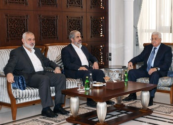 Palestinian President Mahmoud Abbas (R) meets with the Chairman of the Hamas Political Bureau, Khaled Mashal (C) and the vice Chairman of the Hamas Political Bureau, Ismail Haniyeh (L) in Doha, Qatar on October 28, 2016.