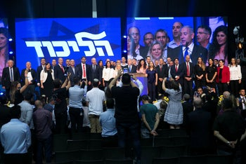 The Likud slate sings Israel's national anthem during a campaign meeting, August 12, 2019