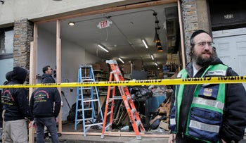 People work to secure the scene of a shooting at a kosher supermarket in Jersey City, N.J. December 11, 2019.