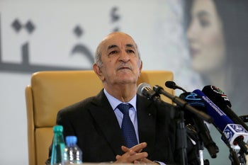 Newly elected president Abdelmadjid Tebboune talks to the press during a news conference, in Algiers, December 13, 2019.