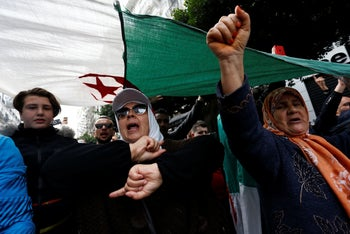 Algerian demonstrators take to the streets in the capital Algiers to reject the presidential elections, in Algiers, December 13, 2019.
