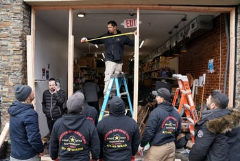 Demolition and recovery crews work at the scene of the shooting at a Jewish Deli, in Jersey City, New Jersey, on December 11, 2019.
