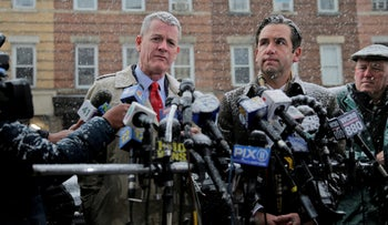 Jersey City's mayor Steven Fulop, right, and the Director of Public Safety James Shea talk to reporters across the street from a kosher supermarket in Jersey City, N.J., Wednesday, Dec. 11, 2019.