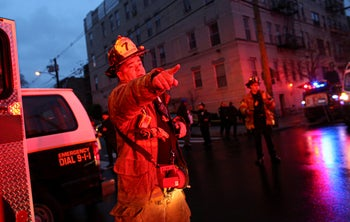 A firefighter attends an emergency on the scene where the active shooting was happening in Jersey City, on December 10, 2019.