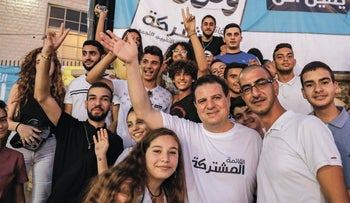 Ayman Odeh poses with supporters during a campaign rally for the Joint List in the Arab town of Kafr Yasif in northern Israel, August 23, 2019.