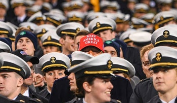 US President Donald Trump watches the game with members of the Navy during the Army-Navy football game in Philadelphia, Pennsylvania on December 14, 2019