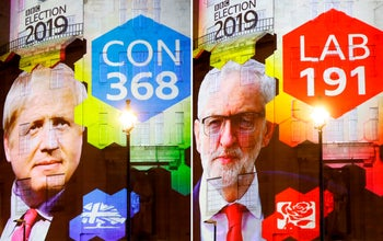 Exit poll results projected outside BBC Broadcasting House in London shows Boris Johnson's Conservative Party's massive predicted win over Jeremy Corbyn's opposition Labour Party. December 12, 2019