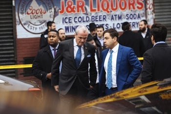 New Jersey Gov. Phil Murphy, center, leaving after visiting a religious school in Jersey City on December 12, a day after a shooting that left three victims dead at a kosher store adjacent to the school.