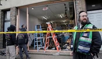 People work to secure the scene of a shooting at a kosher supermarket in Jersey City, New Jersey, December 13, 2019.