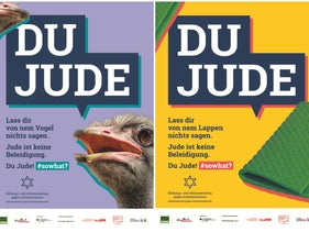 """Billboards in Berlin with the inscription 'Du Jude' [""""You're a Jew"""" or """"You Jew""""] alongside pictures of an ostrich and a rag."""