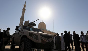 Military armoured vehicle securing worshippers outside Al Rawdah mosque is seen during the first Friday prayer after the attack in Bir Al-Abed, Egypt, December 1, 2017.