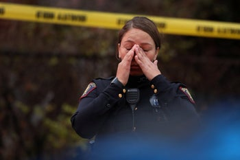 A Jersey City police officer reacts at the scene of a shooting that left multiple people dead on December 10, 2019 in Jersey City, New Jersey.
