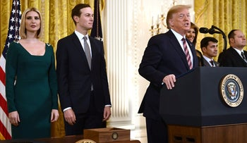 Ivanka Trump and her husband Jared Kushner stand behind U.S. President Donald Trump as he speaks at the White House on December 11, 2019.